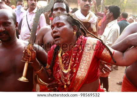 KODUNGALLUR, INDIA - MAR 25 : Unidentified woman oracle perform a frenzy dance during the festival at Kodungallur Bhagavathi temple on March 25, 2012 in Kodungallur, Kerala,India.