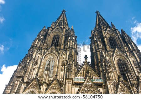 Koelner Dom of Saint Peter and Mary (Cologne Cathedral) over blue sky. UNESCO World Heritage Site. - stock photo