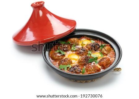 kofta tajine, kefta tagine, moroccan cuisine, lamb meatballs with eggs - stock photo