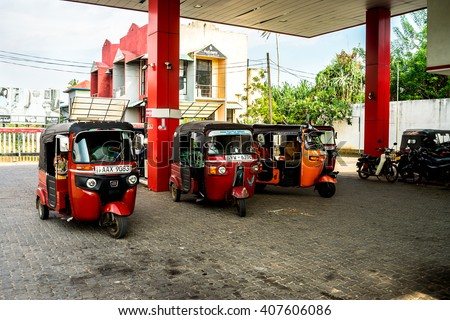 KOGGALA, SRI LANKA - 22 March, 2016: Tuktuk taxi drivers on the gas station of Koggala. Tuktuk is the Sri Lanka nickname given to an auto-rickshaw, a three-wheeled miniature truck.