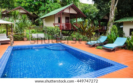 KOH CHANG, THAILAND - 2 APRIL, 2015: Hotel Saint Tropez. Swimming pool in a tropical garden