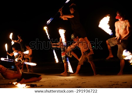 KOH SAMED, THAILAND - MARCH 24: Firestarters public show at the beach of the Koh Samed Samet island Thailand, on March 24, 2015.  - stock photo