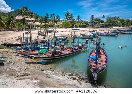 Koh Samui, Thailand - April 25th 2016 - Fisherman boats in amazing beach in Koh Samui, Thailand.