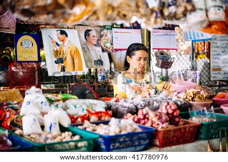 KOH SAMUI, THAILAND - MARCH 14, 2016: One of the shop owners at one of the street markets at Koh Samui, Thailand.