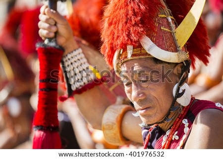 KOHIMA, NAGALAND/INDIA - DECEMBER 3, 2013: Tribesmen of Nagaland at the annual Hornbill festival. The Hornbill is also known as the Festival of Festivals'. - stock photo