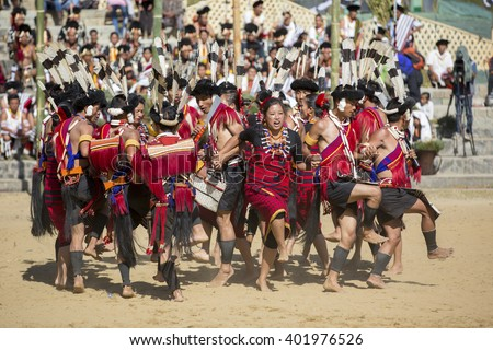 KOHIMA, NAGALAND/INDIA - DECEMBER 3, 2013: Tribesmen of Nagaland perform their traditional tribal dance at the annual Hornbill festival. The Hornbill is also known as the Festival of Festivals'. - stock photo