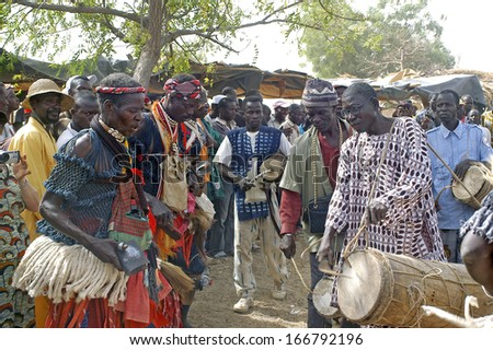 KOKEMNOURE, BURKINA FASO - FEBRUARY 24: Establishment of the new chief of village of Kokemnoure. The warlike dancers opens the beginning of the ceremony by dances, february 24, 2007 - stock photo
