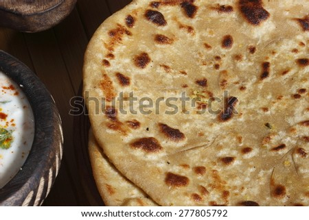 Koki - Thick flatbread or Chapati made with onions and coriander or just plain salt and pepper