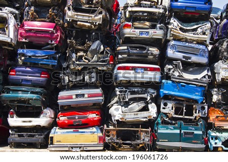 KOKOMO, INDIANA - CIRCA AUGUST 2013 - A Pile of Stacked Junk Cars - Discarded Junk Cars Piled Up After Crushing  - stock photo