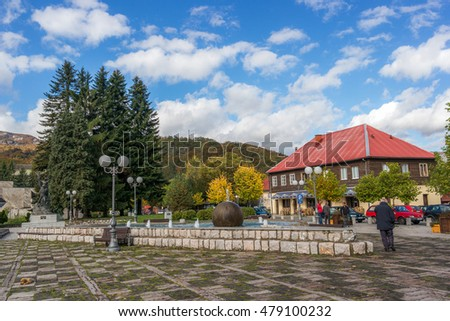 KOLASIN, MONTENEGRO - OCTOBER 17, 2015: Fountain and scene of Trg Borca square.