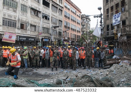 KOLKATA - APRIL 1: Indian army and the rescue team during the rescue effort after an under construction flyover collapsed killing 27 people on April 1, 2016 in Kolkata, India.