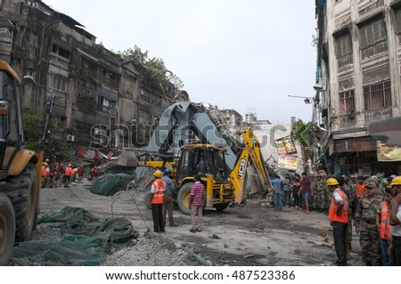 KOLKATA - APRIL 1: Rescue team standing in front of the destroyed bridge during the rescue effort after an under construction flyover collapsed killing 27 people on April 1, 2016 in Kolkata, India.