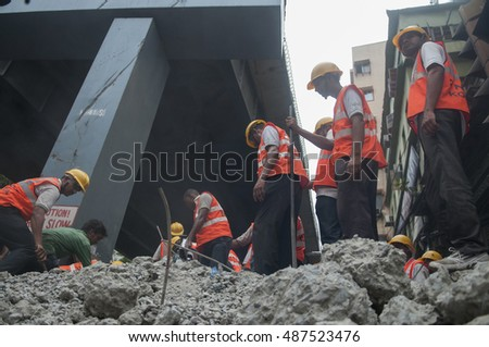 KOLKATA - APRIL 1: Rescue workers cutting through debris to find survivors during the rescue effort after an under construction flyover collapsed killing 27 people on April 1, 2016 in Kolkata, India.