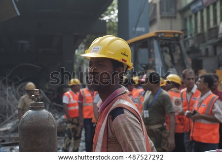 KOLKATA - APRIL 1: Rescuers cleaning up during the rescue effort after an under construction flyover collapsed killing 27 people on April 1, 2016 in Kolkata, India.