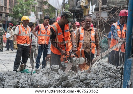 KOLKATA - APRIL 1: Workers cutting concrete with gas cutters during the rescue effort after an under construction flyover collapsed killing 27 people on April 1, 2016 in Kolkata, India.