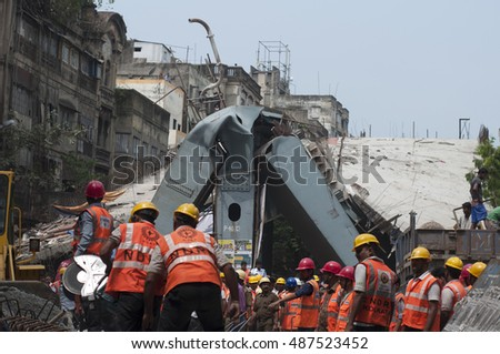 KOLKATA - APRIL 1: Workers trying to look for survivors or dead bodies during the rescue effort after an under construction flyover collapsed killing 27 people on April 1, 2016 in Kolkata, India.