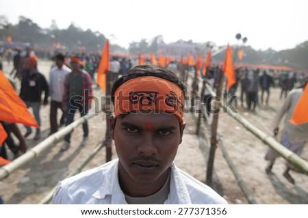 "KOLKATA - DECEMBER 20: A man wearing ""Hail Lord Ram"" headbands during the Golden Jubilee celebration of Vishwa Hindu Parishad (VHP) - on December 20, 2014 in Kolkata, India. - stock photo"