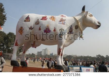 KOLKATA - DECEMBER 20: Dummy of a cow- considered sacred in Hindu mythology during the Golden Jubilee celebration of VHP - a Hindu nationalist organization on December 20, 2014 in Kolkata, India. - stock photo