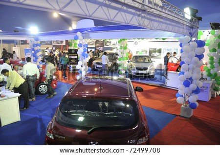 KOLKATA- FEBRUARY 20:  A view of different household cars at display ,during the Information and Communication Technology (ICT) conference and exhibition in Kolkata, India on February 20, 2011. - stock photo