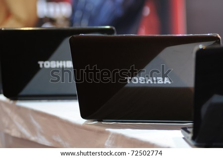KOLKATA- FEBRUARY 20: Toshiba Laptops on display  during the Information and Communication Technology (ICT) conference and exhibition in Kolkata, India on February 20, 2011 in Kolkata, India. - stock photo