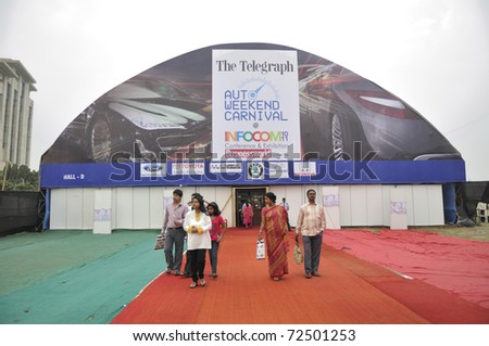 KOLKATA- FEBRUARY 20: Visitors coming out of the auto industry booth during the Information and Communication Technology (ICT) conference and exhibition in Kolkata, India on February 20, 2011. - stock photo