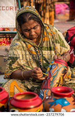 KOLKATA, INDIA - DECEMBER 11: An Indian craftswoman creates colorful handicraft items for sale during the annual State Handicrafts Expo 2014 on December 11, 2014 in Kolkata, West Bengal, India.