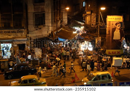KOLKATA, INDIA - FEB 10: Dark city traffic blurred in motion at late evening on crowded streets on February 10, 2014 in Calcutta. Kolkata has a density of 814.80 vehicles per km road length - stock photo