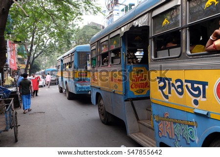 KOLKATA, INDIA - FEBRUARY 11: People on the move come in the colorful bus in Kolkata, India on February 11, 2016.