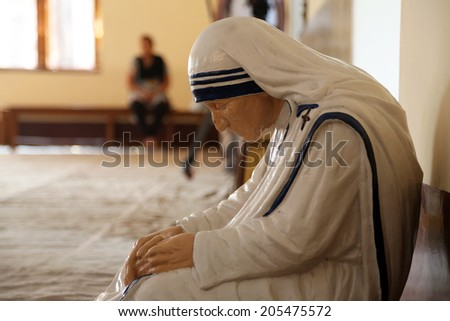 KOLKATA, INDIA - FEBRUARY 08: The statue of Mother Teresa in the chapel of the Mother House, Kolkata, India at February 08, 2014. The statue was made in the pose in which the Mother prayed. - stock photo