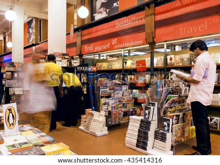KOLKATA, INDIA - JAN 10: Young people choose the magazines and books inside the popular bookshop on January 10, 2016. From 1976 Kolkata have the Book Fair with 2 million visitors annual - stock photo