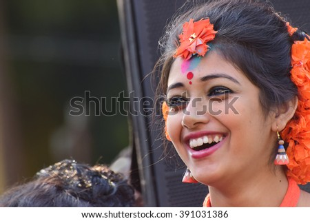 KOLKATA , INDIA - MARCH 5, 2015 : Young girl dancer's joyful expression at Holi / Spring festival, known as Dol (in Bengali) or Holi (in Hindi) celebrating arrival of Spring in India.Popular festival. - stock photo