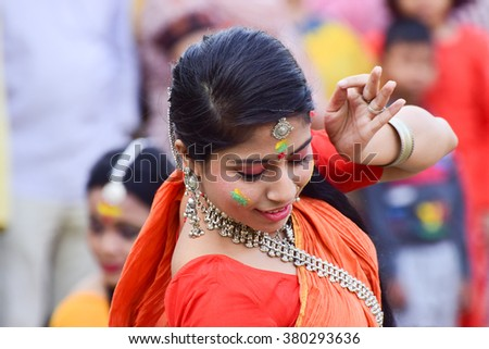 KOLKATA , INDIA - MARCH 5, 2015 : Young girl dancers performing at Holi / Spring festival, known as Dol (in Bengali) or Holi (in Hindi) celebrating arrival of Spring in India. A big popular festival. - stock photo