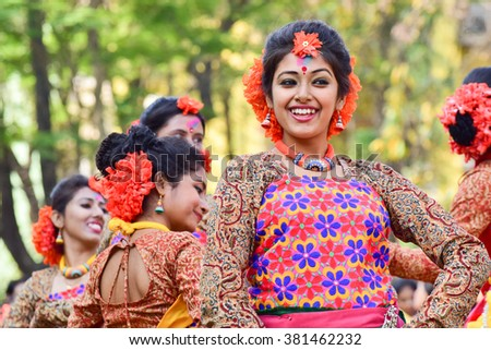 KOLKATA , INDIA - MARCH 5, 2015 : Young girl dancers performing at Holi / Spring festival, known as Dol (in Bengali) or Holi (in Hindi) celebrating arrival of Spring in India. A popular festival. - stock photo
