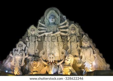 KOLKATA , INDIA - OCTOBER 18, 2015 : Close up of World's biggest Durga idol at Durga Puja festival, 70 feet tall, made of clay in Kolkata, West Bengal, India. Biggest religious festival of Hinduism.  - stock photo