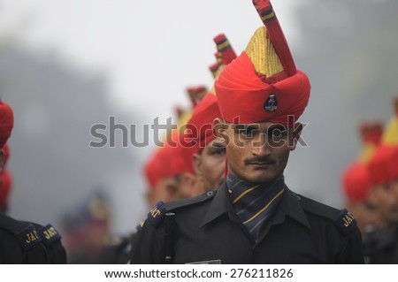 KOLKATA -JANUARY 19 : A soldier of the Jat Regiment - an infantry regiment of the Indian Army  sharing a look  during the Republic Day Parade preparation on January 19, 2015 in Kolkata, India. - stock photo