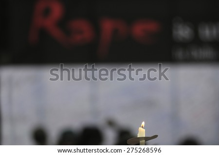 KOLKATA - MARCH 16 : A candle burning while people write solidarity messages during a candle light vigil to protest gang rape of an elderly nun on March 16, 2015, at Allen Park in Kolkata, India.