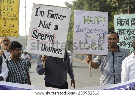 "KOLKATA - NOVEMBER 15 :A man holding a sign which says ""I am a father not a sperm donor""  during a rally to celebrate the International Men's Day on November 15, 2014 in Kolkata, India."
