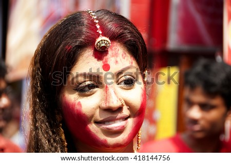 KOLKATA - OCT 17 : Unidentified Hindu woman play with vermilion during Sindur Khela traditional ceremony on the final day of Durga Puja festival on October 17, 2010 in Kolkata, India. - stock photo