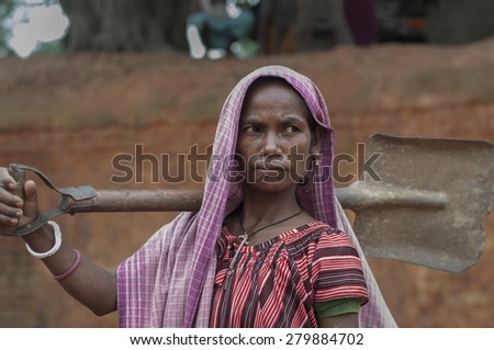 KOLKATA - OCTOBER 26 : A woman worker-one of many women working in brick manufacturing industry where they live and work under unhealthy and unsafe conditions on October 26, 2014 in Kolkata , India. - stock photo