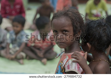 KOLKATA - OCTOBER 26 : Underprivileged kids of brick factory workers sharing a look where their parents stay and work under inhuman conditions at times on October 26, 2014 in Kolkata , India. - stock photo