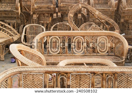 KOLKATA, WEST BENGAL , INDIA - NOVEMBER 23RD 2014 : Cane furnitures , handicrafts on display during the Handicraft Fair in Kolkata - the biggest handicrafts fair in Asia. - stock photo