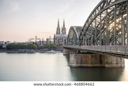 Koln cityscape with cathedral and steel bridge, Germany, Europe