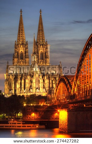 Koln, Germany. Image of Cologne with Cologne Cathedral during twilight blue hour. Close up - stock photo
