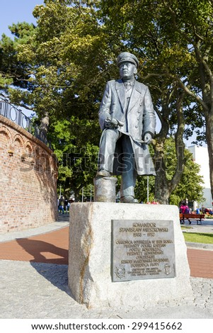 KOLOBRZEG, POLAND - JULY 15, 2015: Monument commemorates the Commander Stanislaw Mieszkowski officer of the Navy. Memorial made of bronze on a granite pedestal, unveiled in 2007 - stock photo