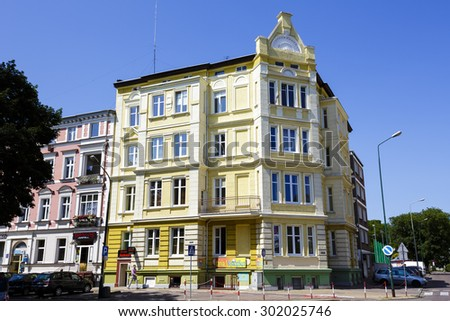 KOLOBRZEG, POLAND - JULY 14, 2015: Townhouse made of brick built in the early 20th century in the style of eclecticism - stock photo