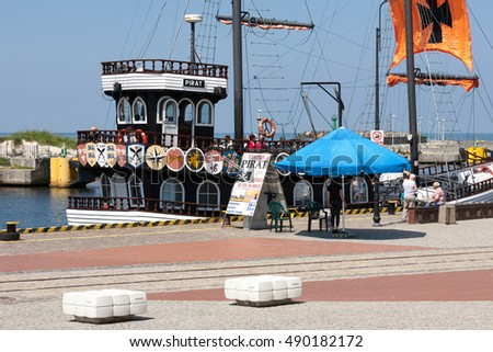 KOLOBRZEG, POLAND - JUNE 22, 2016: Cruise ship moored at the wharf. The ship that is called The Pirate encourages to cruise on its board