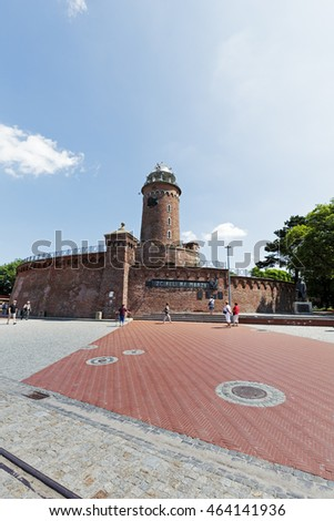 KOLOBRZEG, POLAND - JUNE 22, 2016: Made of red brick building of the lighthouse that is for the purposes of navigation but it is also recognizable tourist attraction
