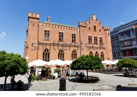 KOLOBRZEG, POLAND - JUNE 23, 2016: Side view of the neo-Gothic building of Town Hall that was built from 1829 to 1832 and rebuilt in 1913