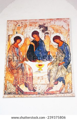 KOLOMNA, RUSSIA - AUGUST 16, 2014: Trinity icon. Old religious painting on church facade. Kremlin in Kolomna, Moscow region, Russia. Popular touristic landmark, place for walking and historic place. - stock photo