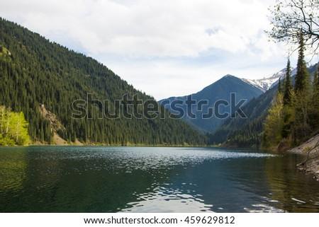 Kolsay mountain lake in Kazakhstan - stock photo